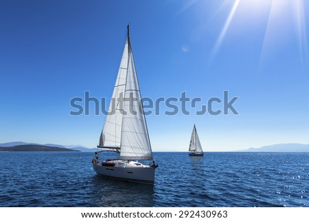 Sailing yacht race. Ship yachts with white sails in the open Sea. Luxury boats.  - stock photo