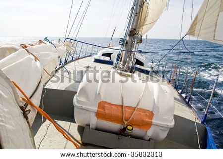 Sailing yacht under the sails - stock photo