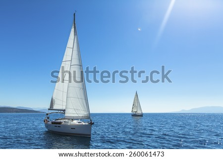 Sailing. Yachting. Tourism. Luxury Lifestyle. Ship yachts with white sails in the open sea.  - stock photo