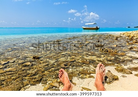 Sailor has a rest on a coral beach, Maldives - stock photo