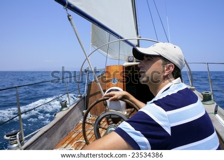 Sailor sailing in the sea. Sailboat over mediterranean blue saltwater - stock photo