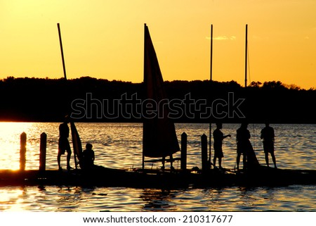 Sailors Enjoy the Sunset on Lake Mendota On July 3rd, 2014 - stock photo