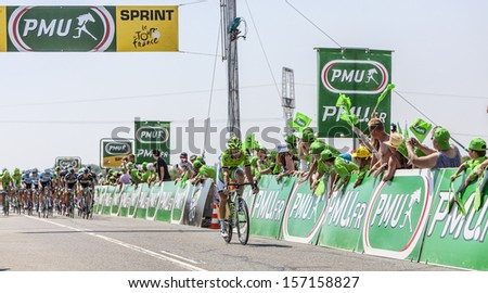 SAINT AOUSTRILLE,FRANCE- JUL 12:Fabio Sabatini passing in the 5th position the finish line of the intermediate sprint during the stage 13 of Le Tour de France 2013 in Saint-Aoustrille, France. - stock photo