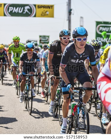 SAINT AOUSTRILLE,FRANCE- JUL 12:Geraint Thomas and the rest of the peloton passing the finish line of the intermediate sprint during the stage 13 of Le Tour de France 2013 in Saint-Aoustrille, France - stock photo