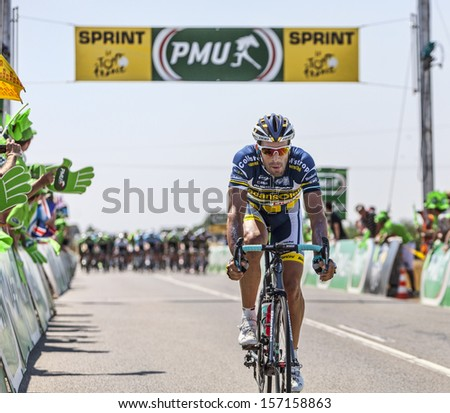 SAINT AOUSTRILLE,FRANCE- JUL 12:Juan Antonio Flecha passing in the 4th position the finish line of the intermediate sprint during the stage 13 of Le Tour de France 2013 in Saint-Aoustrille, France. - stock photo