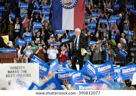 Saint Charles, MO, USA - March 14, 2016: US Senator and Democratic Presidential Candidate Bernie Sanders enters stage during a campaign rally at the Family Arena in Saint Charles, Missouri. - stock photo