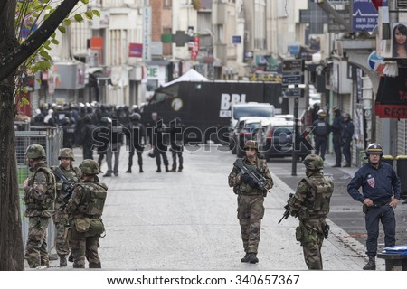 SAINT-DENIS near Paris, FRANCE - NOVEMBER 18, 2015 : intervention of the French anti-terrorist force to stop the radical Islamists involved in the terrorist attacks in Paris on 13 November 2015. - stock photo