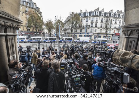 SAINT-DENIS near Paris, FRANCE - NOVEMBER 18, 2015 : Medias in front of the intervention of French police to stop the radical Islamists involved in the terrorist attacks in Paris on 13 November 2015. - stock photo