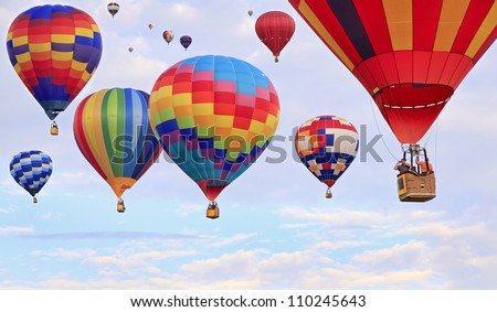 SAINT JEAN SUR RICHELIEU, CANADA, AUGUST 13. The largest gathering of hot air balloons in Canada, include the magical lift-offs of 125 balloons on June 13, 2012 in Saint Jean sur Richelieu, Canada. - stock photo