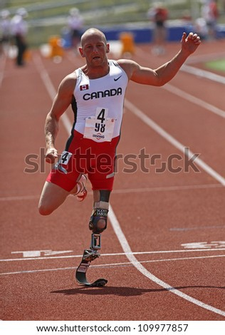 SAINT JOHN, CANADA - AUGUST 10: Canadian Paralympic amputee Earle Connor sprints at the North, Central American & Caribbean Masters Track & Field Championships August 10, 2012 in Saint John, Canada. - stock photo