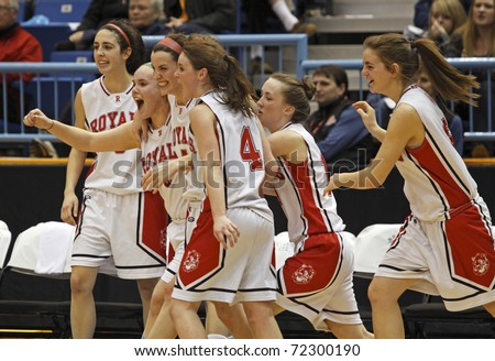 SAINT JOHN, CANADA - FEBRUARY 26: Riverview celebrates their 71-48 win over Woodstock at the NB high school senior girls AAA basketball final February 26, 2011 in Saint John, Canada. - stock photo