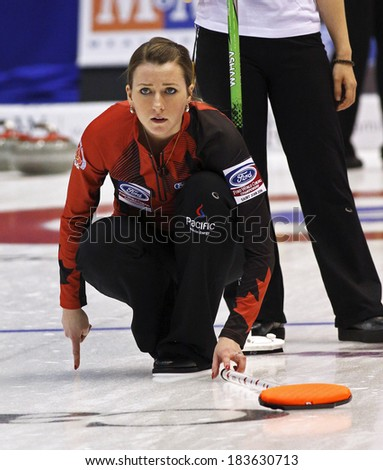 SAINT JOHN, CANADA - March 19: Emma Miskew of Canada tracks an approaching stone at the Ford World Women's Curling Championship March 19, 2014 in Saint John, Canada. - stock photo