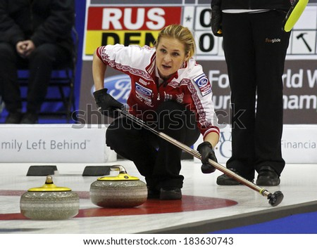 SAINT JOHN, CANADA - March 19: Margarita Fomina of Russia follows the approaching rock at the Ford World Women's Curling Championship March 19, 2014 in Saint John, Canada. - stock photo
