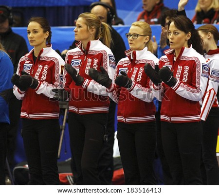 SAINT JOHN, CANADA - March 19: Russia's Anna Sidorova, Margarita Fomina, Alexandra Saitova and Ekaterina Galkina at the Ford World Women's Curling Championship March 19, 2014 in Saint John, Canada. - stock photo