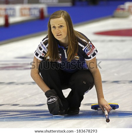 SAINT JOHN, CANADA - March 19: Skip Kerry Barr of Scotland follows the stone at the Ford World Women's Curling Championship March 19, 2014 in Saint John, Canada. - stock photo
