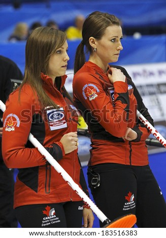 SAINT JOHN, CANADA - March 19: Skip Rachel Homan and third stone Emma Miskew of Canada at the Ford World Women's Curling Championship March 19, 2014 in Saint John, Canada. - stock photo
