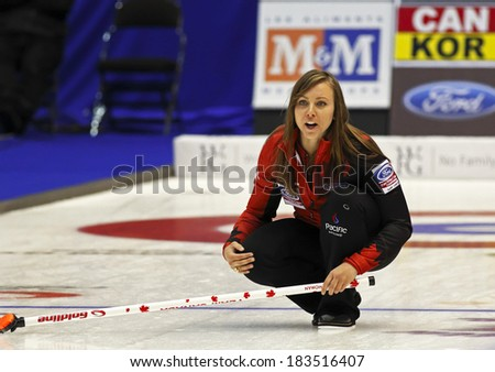 SAINT JOHN, CANADA - March 19: Skip Rachel Homan of Canada instructs her sweepers at the Ford World Women's Curling Championship March 19, 2014 in Saint John, Canada. - stock photo