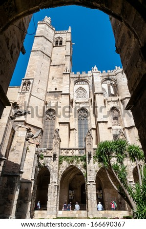 Saint Just Cathedral sight between arcs in cloister at Narbonne - France - stock photo