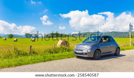 SAINT-LIZIER, FRANCE - JULY 24, 2014: Fiat 500 (Type 312) parked in the French country side in the Midi Pyrenees. The Fiat 500 is a city car built by Italian automaker Fiat since 2007. - stock photo