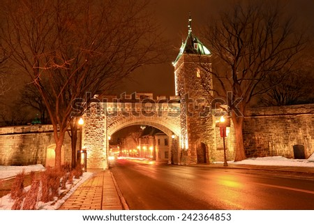 Saint Louis Gate at night, Quebec, Canada. Located in Canada, the Ramparts of Quebec City are the only remaining fortified city walls in North America north of Mexico and St. Augustine, Florida - stock photo