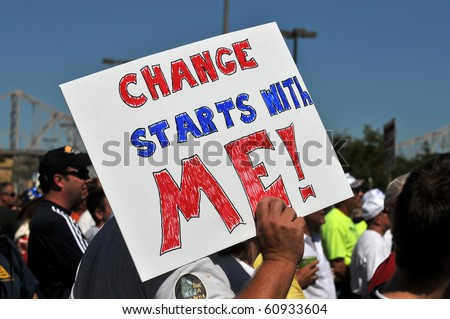 SAINT LOUIS, MISSOURI - SEPTEMBER 12: Man holding sign at rally of the Tea Party Patriots in Downtown Saint Louis under the Arch, on September 12, 2010 - stock photo
