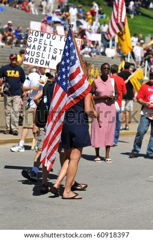 SAINT LOUIS, MISSOURI - SEPTEMBER 12: Rally of the Tea Party Patriots in Downtown Saint Louis under the Arch, on September 12, 2010 in Saint Loius, Missouri - stock photo