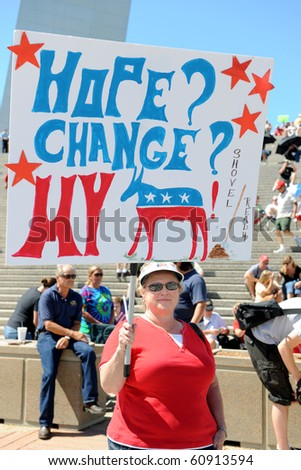 SAINT LOUIS, MISSOURI - SEPTEMBER 12: Woman holding sign at rally of the Tea Party Patriots in Downtown Saint Louis under the Arch, on September 12, 2010 - stock photo