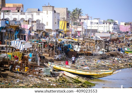 SAINT-LOUIS/SENEGAL - NOVEMBER 13, 2013: Senegalese children playing on the garbage heaps at the coast of Saint-Louis city in Senegal. - stock photo