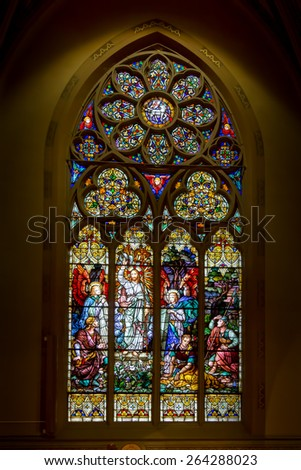 SAINT LOUIS, UNITED STATES - MARCH 11: Stained glass of the resurrection of Christ in St John Nepomuk Church on March 11, 2015.  St.John Nepomuk is the oldest Czech Roman Catholic church in the US - stock photo