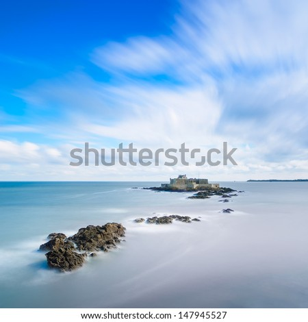 Saint Malo beach, Fort National and rocks during High Tide. Brittany, France, Europe. Long exposure photography - stock photo