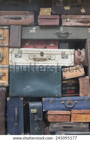 SAINT-MALO, FRANCE - JULY 6, 2011: Ancient suitcases in window display in Saint-Malo, France. Saint-Malo is the main tourist attraction of Brittany in France. - stock photo