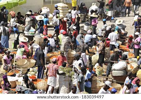 SAINT MARC, HAITI - FEB 12, 2014.  An overhead view of a busy Haitian marketplace. - stock photo