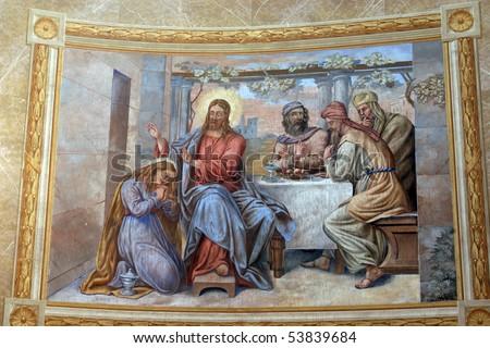 Saint Mary Magdalene wipes the feet of Jesus - stock photo