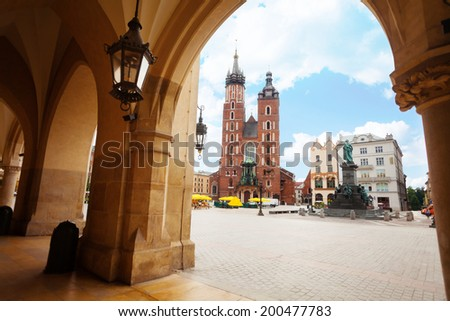 Saint Mary's Basilica and Rynek Glowny in Krakow - stock photo