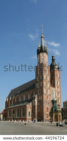 Saint Mary's Basilica in Krakow, famous city square in Poland. - stock photo
