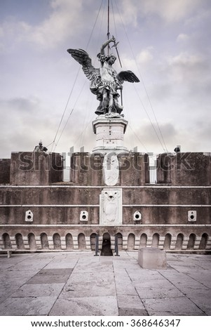 Saint Michael statue on the top of Castel Sant`Angelo in Rome - stock photo