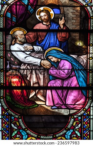 Saint Michel sur Orge, France - 15June 2014 : Stained glass in french church. Biblical scene  : Jesus Christ by the bedside of dying a Saint. - stock photo