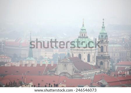 Saint Nicholas Church in Mala Strana viewed from Petrin Hill in Prague, Czech Republic. - stock photo