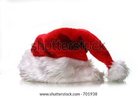 saint nicks furry red holiday hat on white with plenty of copy space - stock photo