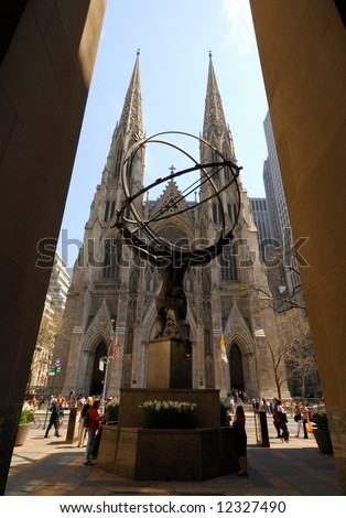 Saint Patrick Cathedral in New York viewed from behind the statue of Atlas from the Rockefeller Center - stock photo