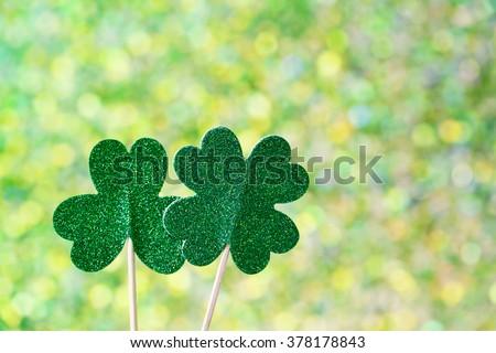 Saint Patricks Day shiny green clover ornaments - stock photo