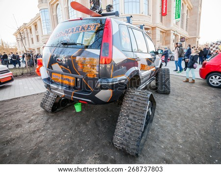 Saint-Petersburg, Russia - April 11, 2015: All-terrain cross-country vehicle on tracks based on European modification of Ford Fusion car, back view - stock photo