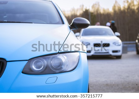 SAINT-PETERSBURG, RUSSIA - APRIL 5, 2014: blue car BMW 3-series at the meeting fans of the Bavarian automaker, St. Petersburg, Russia - stock photo