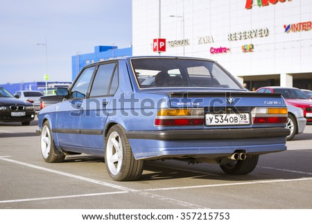 SAINT-PETERSBURG, RUSSIA - APRIL 5, 2014: Blue old-car BMW 5-series at the meeting fans of the Bavarian automaker, St. Petersburg, Russia - stock photo