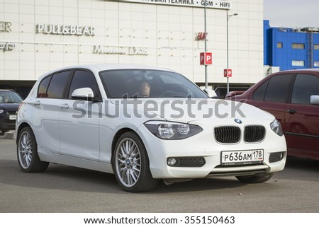 SAINT-PETERSBURG, RUSSIA - APRIL 5, 2014: Car BMW 1-series white color at the meeting fans of the Bavarian automaker, St. Petersburg, Russia - stock photo