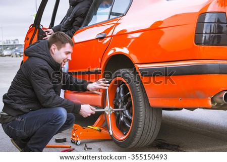 SAINT-PETERSBURG, RUSSIA - APRIL 5, 2014: Replacement car wheels for old-car BMW 5-series e34 at the meeting fans of the Bavarian automaker, St. Petersburg, Russia - stock photo