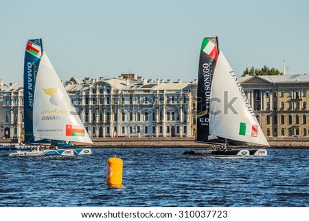 SAINT-PETERSBURG, RUSSIA - AUGUST 23, 2015: Lino Sonego Team Italia and Oman Air at Extreme Sailing Series Act 6 catamarans race on 20th-23th august 2015 in St. Petersburg, Russia - stock photo