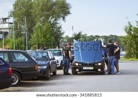 SAINT-PETERSBURG, RUSSIA - AUGUST 3, 2013: Old-car BMW 5-series e34, at the meeting, fans of the Bavarian automaker, Krestovsky island, St. Petersburg - stock photo