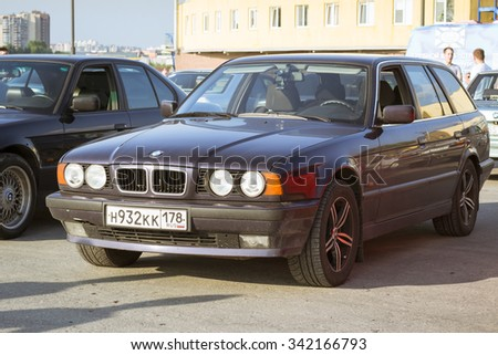 SAINT-PETERSBURG, RUSSIA - AUGUST 3, 2013: Old-car BMW 5-series e34 at the meeting, fans of the Bavarian automaker, Krestovsky island, St. Petersburg - stock photo