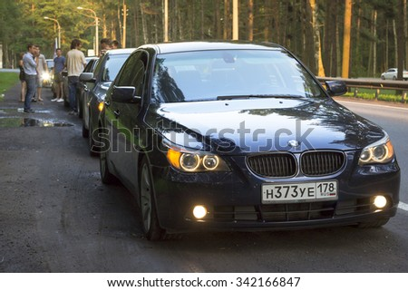 SAINT-PETERSBURG, RUSSIA - AUGUST 3, 2013: Old-car BMW 5-series e60 at the meeting, fans of the Bavarian automaker, Primorskoye shosse, St. Petersburg - stock photo